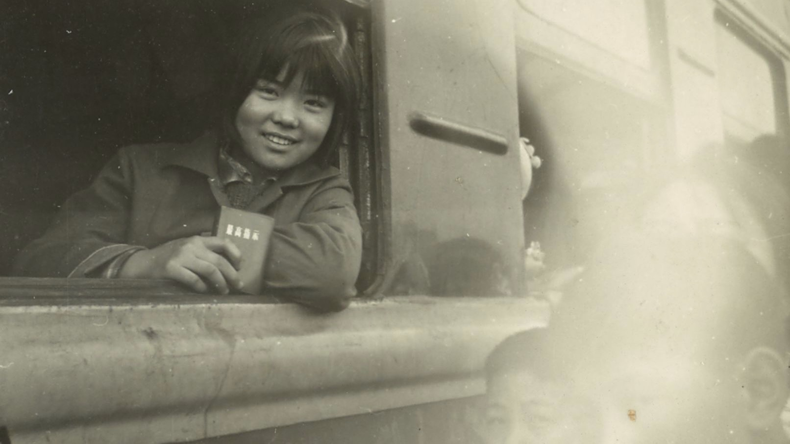 image of a girl riding a train in Shanghai in 1970