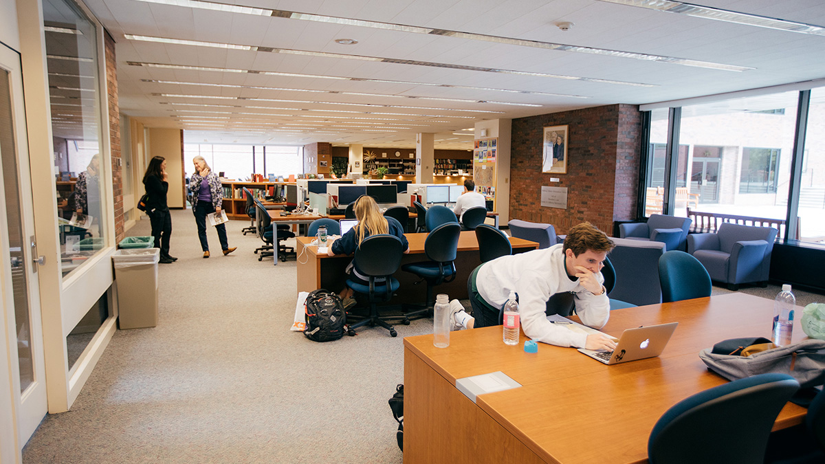 Student looks at computer in the Feldberg Library at Dartmouth