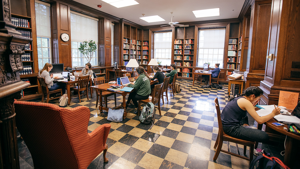 A wide view of a room with students studying