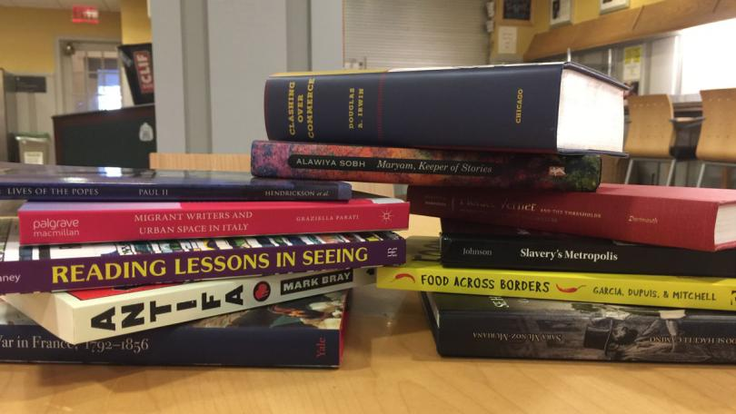 Pile of newly published books by Dartmouth authors