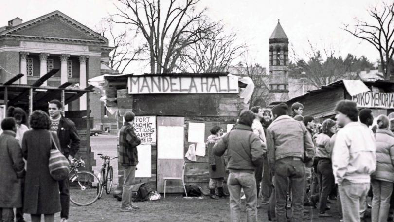 Students stand near Mandela Hall shanty on the Dartmouth Green