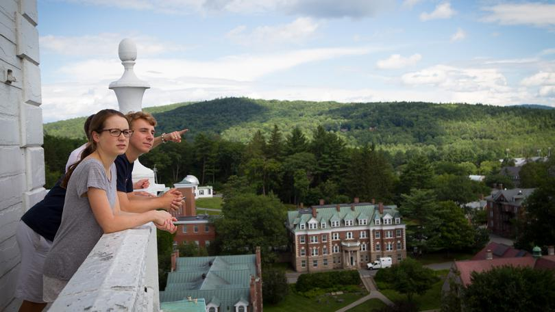 People look out over Dartmouth campus from the Baker-Berry tower