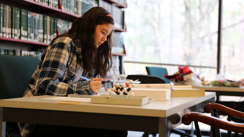 A student uses a molecular model kit in Kresge Library at Dartmouth