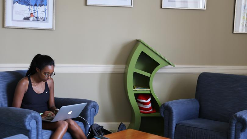 Student studies in Dr. Seuss room in Baker-Berry Library
