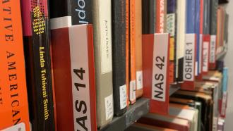 Books on shelf with Course label NAS 14