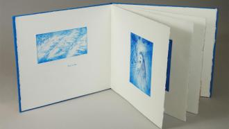 A small artist book centered on the sea, with copper etchings paired w/ brief snippets of poems about the sea.
