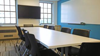 A conference room with tables and chairs