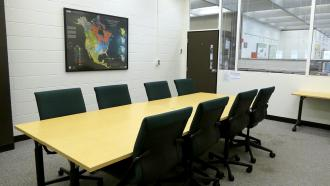 Conference room with table and chairs in Kresge Library.