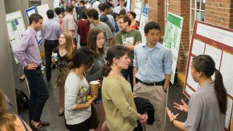 Students present posters in Baker-Berry Library