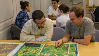 Two students looking at a map together