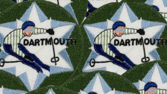 Repeating patches show a Dartmouth skier